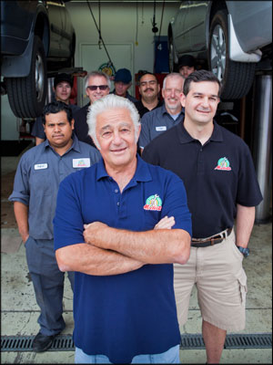 A NEW GENERATION: John Modesti, center, has been the face of Modesti's Car Care Center since launching it as a one-man operation in 1972. The business, now with a staff of 11, is being turned over to John's son, Nick Modesti, to his right. Photo by Ron Villanueva