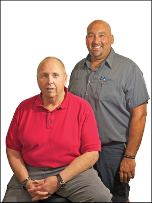 BEYOND REPAIRS: John Francis Jr., left, and son John Francis III, grew their customer base at Francis Automotive through community-focused initiatives such as distributing child I.D. kits.  Photo by Stephen Geffre