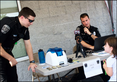 Director of operations Jacquie Hower organized a kids ID station with the police department. Photo by Stuart Leask