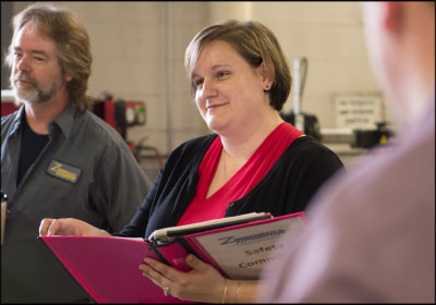 IMMERSED IN COMMUNITY: While director of operations Jacquie Hower will provide extra help in the shop, from administrative work to performing oil changes, she spends most of her time in the community promoting the business. Photo by Stuart Leask