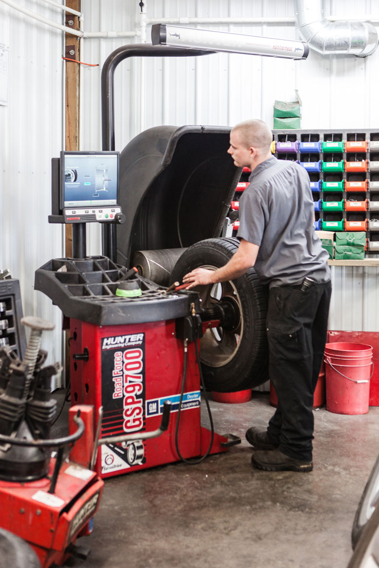 Careful Approach: Mavert  Automotive purchased used tire equipment (like the machine at left) through a supplier to curb costs and ensure quality