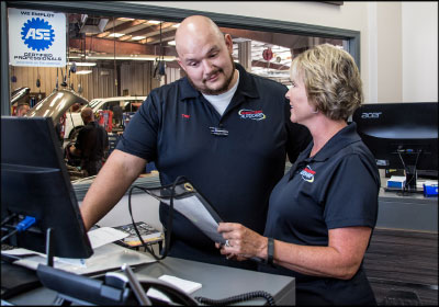 THINKING OUTSIDE THE BOX: Teresa Brewer (near left) has been instrumental in implementing processes in the front office of Douglas County AutoCare that have resulted in improved efficiency and profitability.