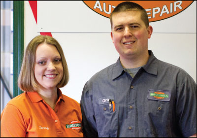 HANDS ON: Running a two-person shop, Chris and Tammy Rahns' personal touch is evident throughout the business. And that carries over into the way they treat their customers at Rahn's Hometown Auto Repair. Photo by Dennis Bullock