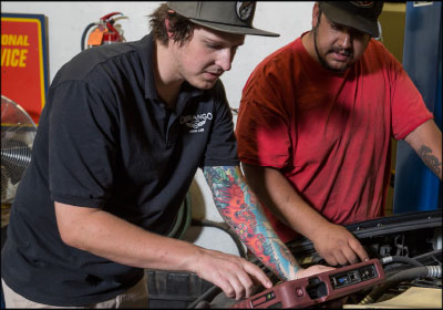 A MODERN APPROACH:  Tyler Jensen, left, worked quickly to update the shop's equipment when he took over ownership, allowing his techs to work in a more modern environment.