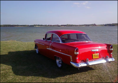 FROM TRASH TO TURNKEY: One of his four Bel Airs, this bright red 1955 Chevy was built to be owner Dan Harris' everyday commuter vehicle. Photo courtesy Dan Harris