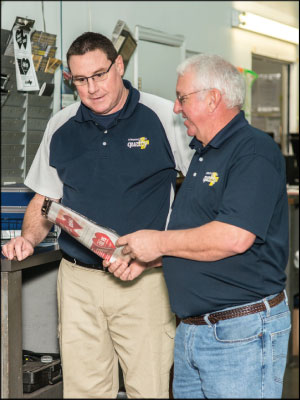 TEAM PLAYER: Randy Bunn, right, gives his employees 'a lot of leeway' in making decisions. Photo by Neil Boyd