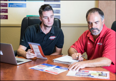 THOUGHTFUL MARKETING: Phil Jackson (left) works with operations manager Chris Callahan (right) to create and budget marketing