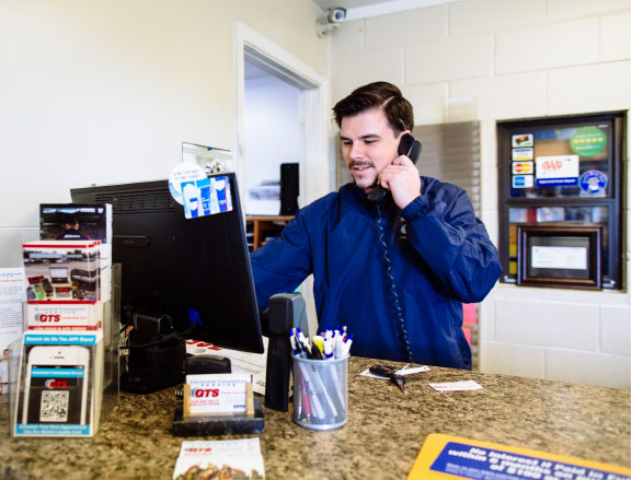 OUT FRONT: Dan Leuck has a proven approach to customer service that enables him to convert phone calls into jobs in the back of the shop.
