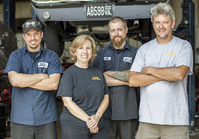 BUILDING A TEAM: Over time, Brenda Ayers (second from left) has created a team, including (from left) Travis Klous, Evan Blair and Glenn Huddleston, to help her run the business and distribute the workload.