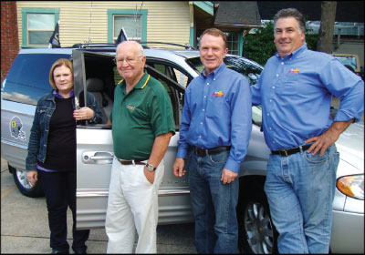 BACK ON THE ROAD: From left, Sun Automotive co-owner Sherrie Buckridge, vehicle winner Bill White, shop co-owner Mike Buckridge, and general manager Craig Noel. Photo courtesy Mike Buckridge