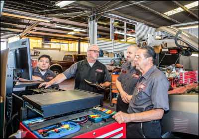 SOLUTION FINDERS: Ted Curran and his team of three technicians work together to find solutions to both customer and shop issues.