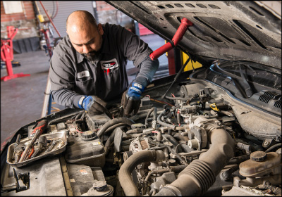 SPEED OF SERVICE: One of Mike Daniel's key to quick service has been a process that allows technicians to complete an oil change and inspection in just seven minutes. Photo by Jason Jones